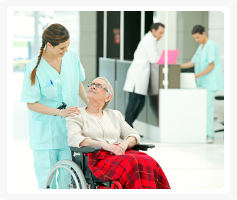 Elderly woman in wheelchair with a caregiver
