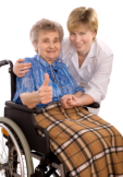 Elderly woman in wheelchair with her caregiver