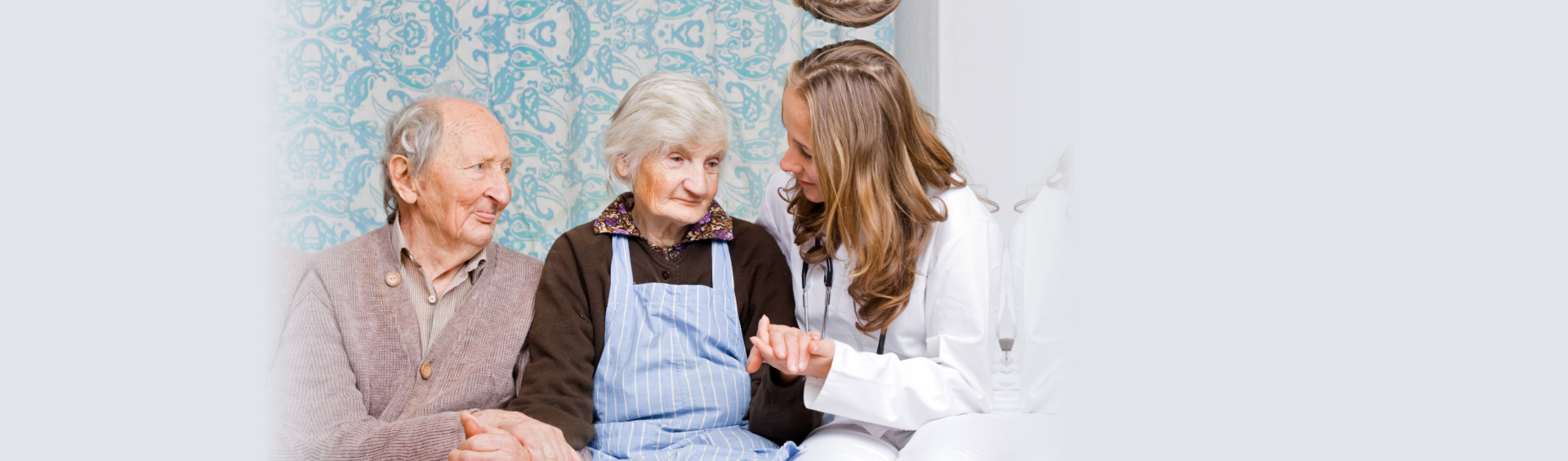 elderly couples with a doctor