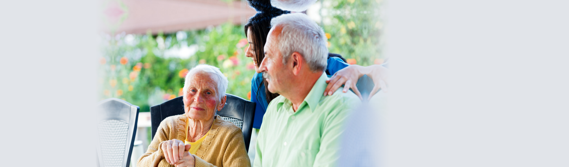 elderly couples with their caregiver