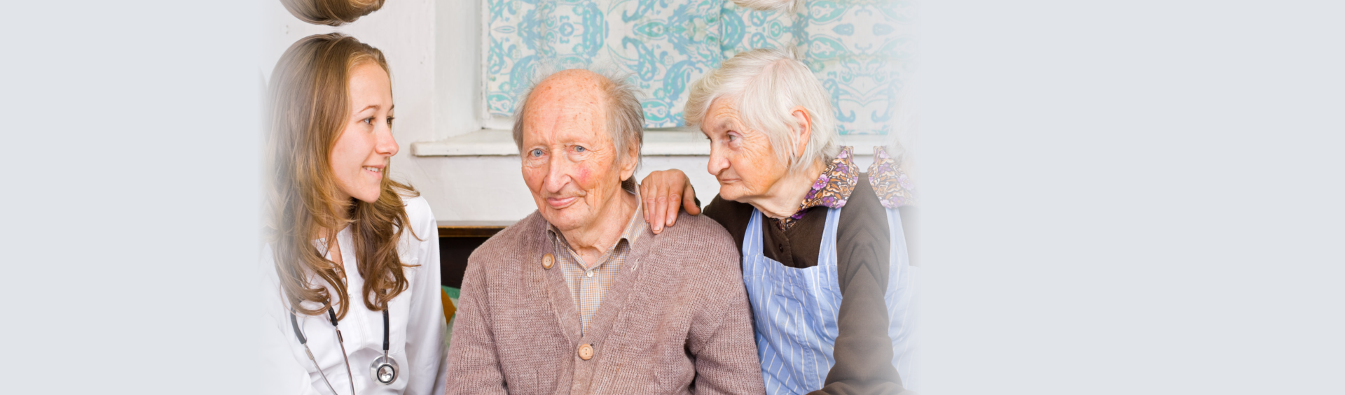 elderly couples with their doctor
