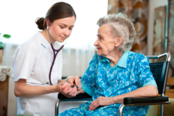 elderly woman being checked by a nurse